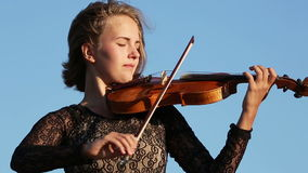Violinist. Young Woman playing the violin in nature stock footage