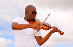 Violinista africano Immagini Stock