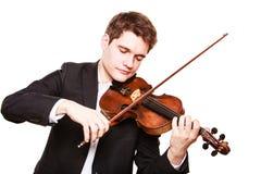 Violinista del hombre que toca el violín. Arte de la música clásica Imagen de archivo libre de regalías