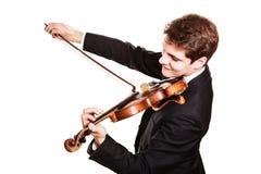 Violinista do homem que joga o violino. Arte da música clássica fotografia de stock