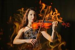 Violinista in fiamma Fotografia Stock