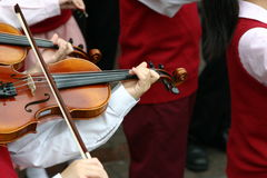 Violinists. A closeup of  young violinists playing their instruments Stock Photos