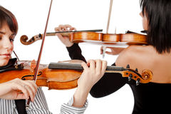 Violinists isolated. Two female violinists playing violins isolated on white Royalty Free Stock Images