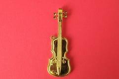 Violino do ouro Fotos de Stock