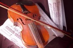 Violino e nota Fotografia Stock