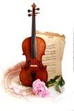 Violino, note e peon antichi Fotografie Stock Libere da Diritti