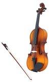 Violinos e um fiddlestick Imagem de Stock