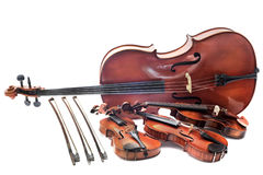 Violins and cello. Beautiful violins isolated on a white background and cello stock photo