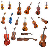 Violins and a fiddlestick. Under the white background Royalty Free Stock Photo