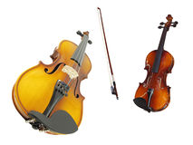 Violins and a fiddlestick. Under the white background Royalty Free Stock Images