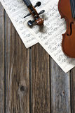 Violins on music paper Stock Photos