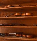 Violins on shelves Royalty Free Stock Images