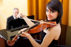 Violist and pianist playing together Royalty Free Stock Photos