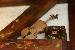 Violon as a decoration at a restaurant royalty free stock photography