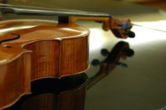 Violoncello. A Violoncello resting on a grand piano Stock Image