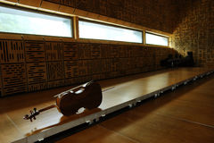 Violoncello in empty classroom. Violoncello laying on the floor in empty classroom royalty free stock photos