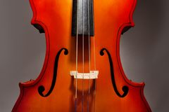 Violoncello fragment on the grey background Stock Images