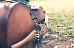 Violoncello lying on the grass Stock Photography