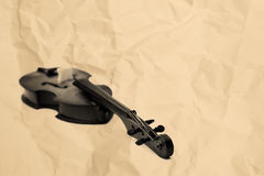 Violoncello on the old paper Royalty Free Stock Photos