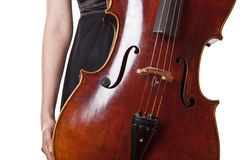 Violoncello playing. Woman in black dress holding violoncello in hand royalty free stock photos