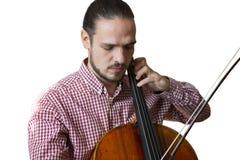 Violoncelo que juega las manos del violoncelista cercanas encima de imagen aislada instrumentos de la orquesta en el fondo blanco foto de archivo libre de regalías