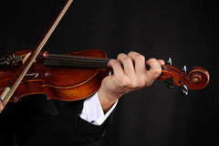 Violonist. Guy in toxido  playing at violin Royalty Free Stock Photos