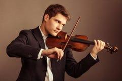 Violoniste d'homme jouant le violon Art de musique classique Image libre de droits