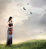 Violoniste sur un dessus de montagne Photos libres de droits