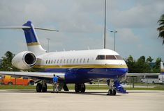 VIP charter jet. Stationary charter jet being inspected before takeoff royalty free stock image