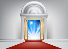 VIP door. A door with a red carpet leading up to it and bright abstract blue light on the other side Stock Images