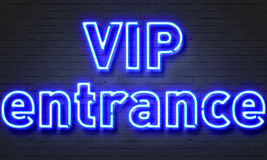 VIP entrance neon sign on brick wall background. Royalty Free Stock Photo