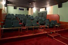 VIP Hall of a cinema. And lines of green armchairs Royalty Free Stock Photos