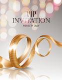 VIP invitation card with curly gold ribbon and blurred lights on the background. Stock Photo