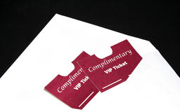 VIP Passes. Two VIP passes in envelope on black Royalty Free Stock Images