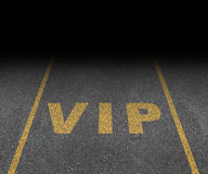 VIP Service. Symbol with a first class reserved parking space for with a sign painted on asphalt as a symbol of exclusive hospitality with the royal treatment Stock Photography
