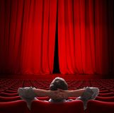 VIP sitting in movie theater red curtain 3d illustration royalty free stock photography