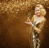 Vip Woman with Champagne Glass Celebrating Holiday Party. Retro Lady in Rich Gold Dress, Sparkling Diamonds Necklace royalty free stock photography