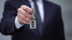 VIP word on keychain in male hand, luxury accommodation for business trip. Stock footage stock video