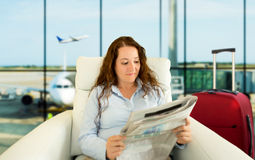 Vip zone aiport. Woman commenting economy news in vip zone aiport Royalty Free Stock Image