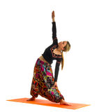Viparita virabhadrasana , a position in Yoga, is also called Reverse Warrior Royalty Free Stock Images