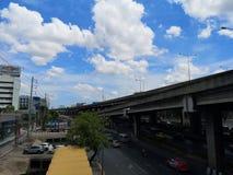 Vipawadee Road,Bangkok, Thailand-May 29,2019 Bright sky white blotches filled with blue Road traffic royalty free stock photo