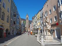 Vipiteno, Bolzano, Trentino Alto Adige. The pedestrian street of the village with the traditional Tyrolean houses. Spring time royalty free stock images
