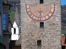 Vipiteno, Bolzano, Trentino Alto Adige. The tower of the Twelve in the pedestrian street of the village. Spring time stock photo
