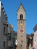 Vipiteno, Bolzano, Trentino Alto Adige. The tower of the Twelve in the pedestrian street of the village. Spring time royalty free stock image