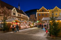 The colorful christmas market in Vipiteno in the evening. Trentino Alto Adige, Italy. Vipiteno is a comune in South Tyrol in northern Italy. It is the main stock photography