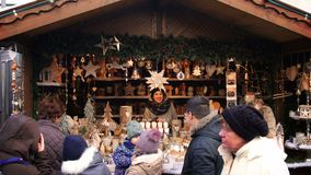 Wooden christmas market stall smiling girl people december crowd europe stock video footage