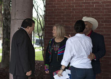 VIPs Conversing. Mayors of two South Texas communities converse with family members royalty free stock image