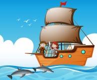 Viquingues no navio e nos golfinhos no mar Imagem de Stock