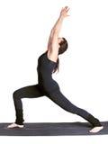 Virabhadrasana excercising de la yoga Imagen de archivo