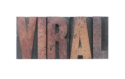 Viral. The word 'viral' in old ink-stained wood type Stock Photos